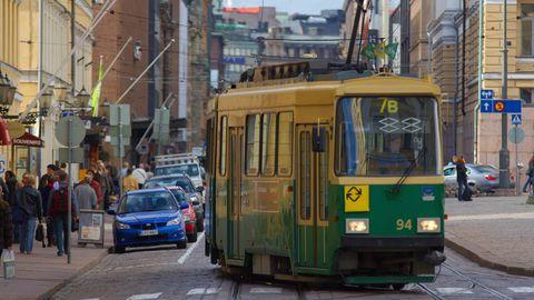 Mode of transport, Transport, Land vehicle, Vehicle, Tram, Neighbourhood, Street, Town, Urban area, Electrical network,