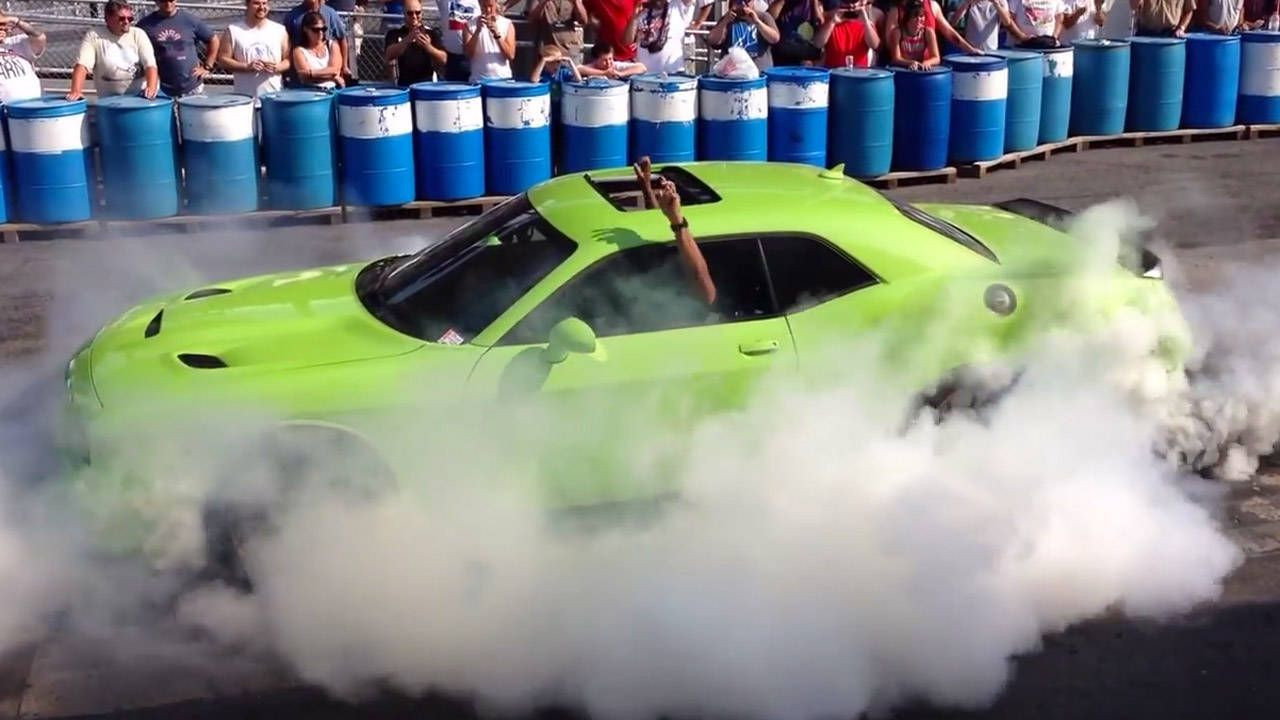 Watch Ralph Gilles incinerate a set of Pirellis with the Dodge Challenger SRT Hellcat