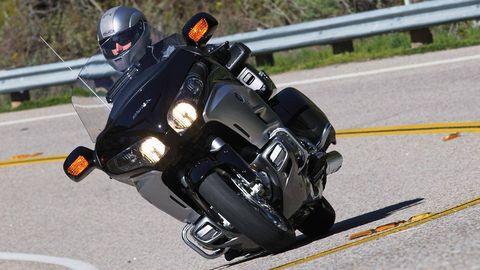 Motorcycle helmet, Motorcycle, Goggles, Helmet, Personal protective equipment, Asphalt, Motorcycling, Motorcycle accessories, Sports gear, Sunglasses,