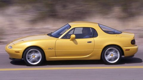 Tire, Wheel, Vehicle, Yellow, Automotive design, Car, Rim, Landscape, Hood, Fender,