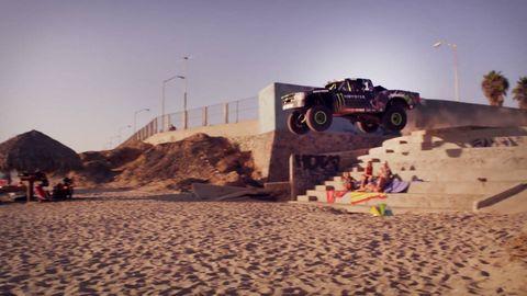 Automotive tire, Automotive design, Sand, Landscape, Soil, Auto part, Aeolian landform, Street light, Tread, Monster truck,