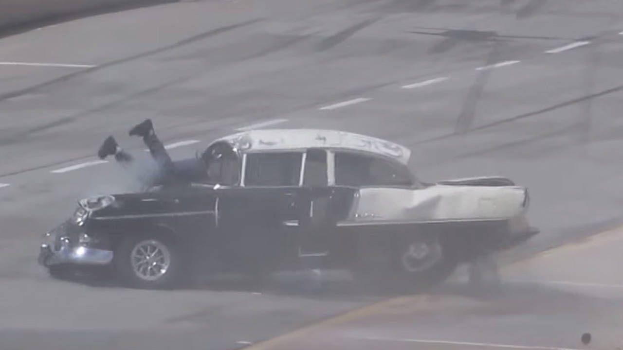 Drag racer rolls '55 Chevy, goes through windshield, walks it off