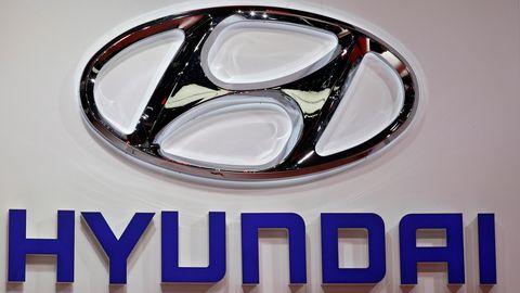 Beverage can, Automotive lighting, Aluminum can, Headlamp, Font, Logo, Automotive light bulb, Brand, Symbol, Circle,