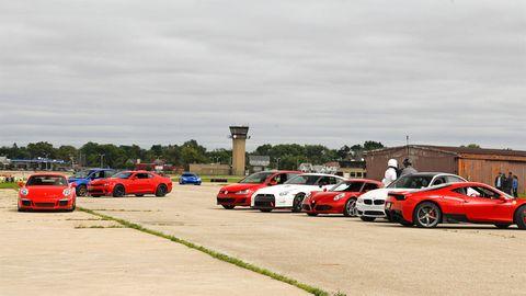 Land vehicle, Automotive design, Vehicle, Automotive parking light, Car, Performance car, Alloy wheel, Parking lot, Automotive lighting, Sports car,