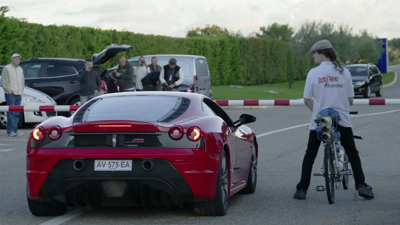 Man on 207-mph bicycle humiliates Ferrari at dragstrip