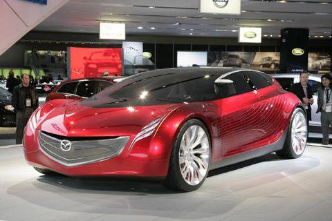Automotive design, Mode of transport, Vehicle, Land vehicle, Event, Car, Auto show, Exhibition, Personal luxury car, Fashion,