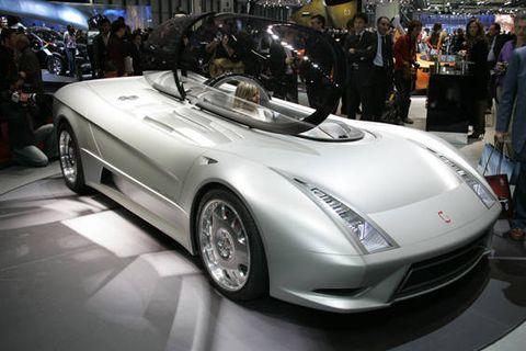 Tire, Wheel, Mode of transport, Automotive design, Vehicle, Land vehicle, Car, Personal luxury car, Auto show, Fender,
