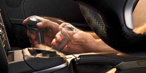 Vehicle door, Vehicle, Car, Hand, Automotive design, Driving, Auto part, Finger, Car seat, Gear shift,