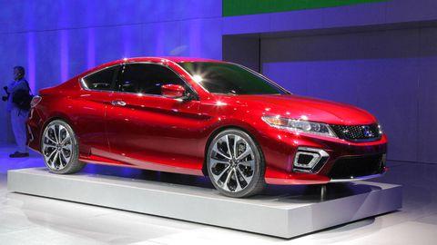Wheel, Mode of transport, Automotive design, Vehicle, Event, Land vehicle, Transport, Car, Red, Mid-size car,