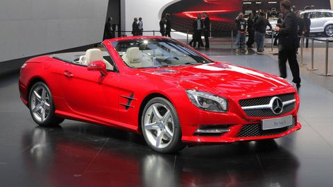 Tire, Wheel, Automotive design, Vehicle, Land vehicle, Car, Performance car, Grille, Red, Personal luxury car,