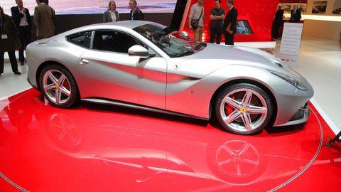 Tire, Wheel, Automotive design, Vehicle, Land vehicle, Car, Automotive wheel system, Rim, Red, Alloy wheel,