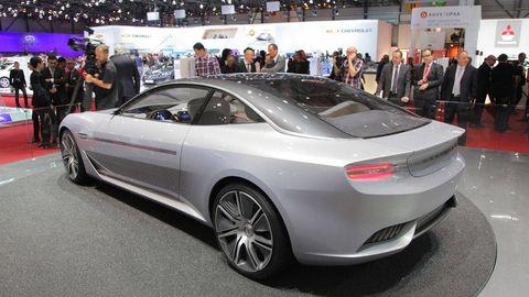 Tire, Mode of transport, Automotive design, Vehicle, Event, Land vehicle, Vehicle registration plate, Car, Personal luxury car, Auto show,