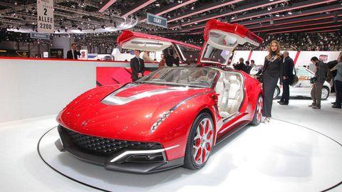 Automotive design, Vehicle, Event, Land vehicle, Car, Auto show, Personal luxury car, Exhibition, Grille, Sports car,