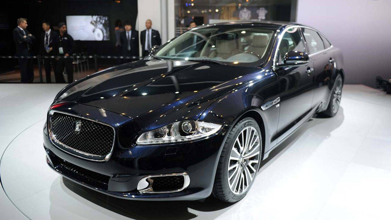 series xj price quarters three front motor awd review first test jaguar trend cars xjl