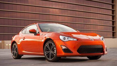 Tire, Wheel, Automotive design, Vehicle, Automotive lighting, Orange, Car, Red, Headlamp, Hood,