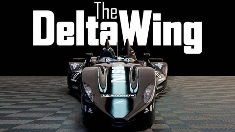 Automotive design, Race car, Logo, Automotive tire, Automotive wheel system, Symbol, Auto part, Sports car, Sports prototype, Brand,