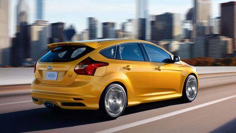 Tire, Wheel, Automotive design, Vehicle, Yellow, Tower block, Car, Rim, Fender, Alloy wheel,