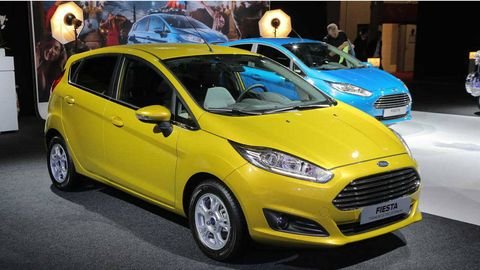 Tire, Wheel, Motor vehicle, Mode of transport, Automotive design, Vehicle, Yellow, Automotive tire, Land vehicle, Transport,