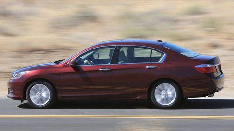 Tire, Wheel, Vehicle, Automotive design, Transport, Car, Red, Full-size car, Automotive tire, Mid-size car,