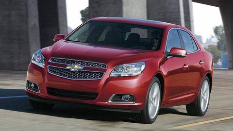 Motor vehicle, Tire, Daytime, Automotive design, Vehicle, Automotive mirror, Transport, Grille, Car, Red,
