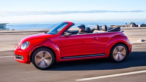 Tire, Wheel, Automotive design, Vehicle, Vehicle door, Car, Red, Fender, Automotive wheel system, Hood,