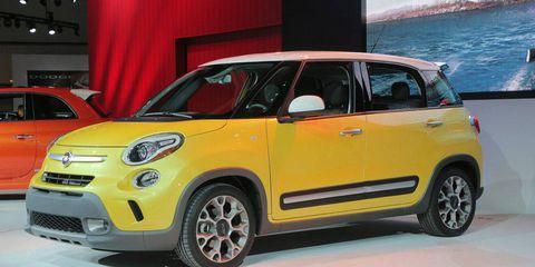 Tire, Motor vehicle, Automotive design, Vehicle, Yellow, Car, Vehicle door, Bumper, Automotive lighting, Hatchback,