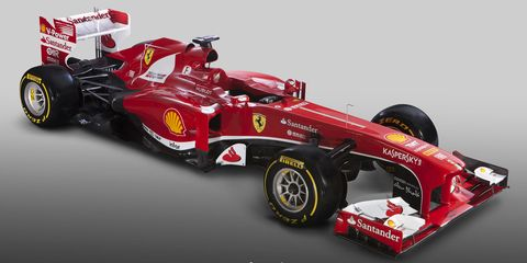 Tire, Wheel, Automotive tire, Automotive design, Open-wheel car, Automotive wheel system, Vehicle, Formula one tyres, Formula one car, Red,