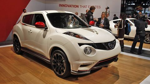 Motor vehicle, Automotive design, Vehicle, Event, Car, Fender, Alloy wheel, Vehicle door, Wood flooring, Auto show,