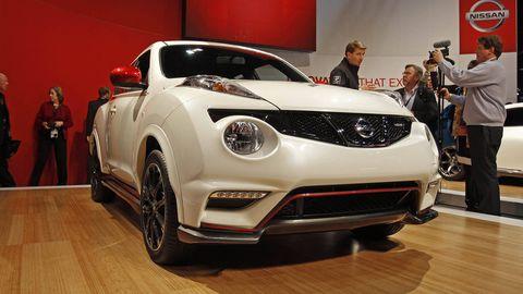 Automotive design, Vehicle, Event, Car, Automotive lighting, Fender, Exhibition, Auto show, Logo, Beauty,