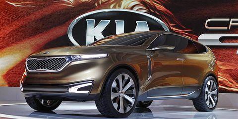 Tire, Wheel, Automotive design, Car, Automotive lighting, Grille, Personal luxury car, Logo, Luxury vehicle, Auto show,