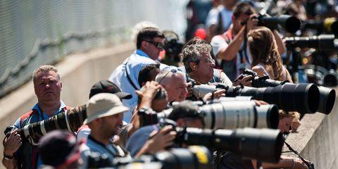 Hat, Cameras & optics, Sunglasses, Video camera, Shooting, Camera, Baseball cap, Camera operator, Lens, Camera lens,