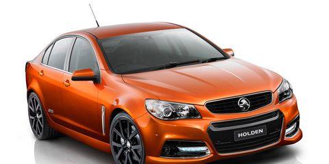 Motor vehicle, Tire, Automotive design, Automotive mirror, Vehicle, Automotive lighting, Hood, Orange, Rim, Headlamp,