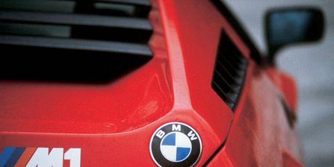 Motor vehicle, Automotive design, Automotive exterior, Red, Logo, Carmine, Symbol, Hood, Sports car, Material property,