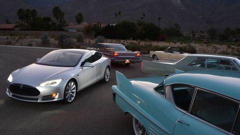 tesla model s and vintage cars