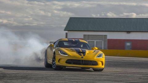 Tire, Automotive design, Yellow, Headlamp, Hood, Automotive tire, Performance car, Car, Motorsport, Automotive lighting,