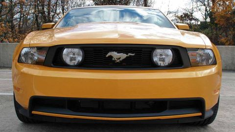 Automotive design, Daytime, Vehicle, Automotive lighting, Yellow, Headlamp, Hood, Grille, Car, Automotive exterior,