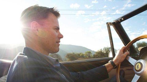 Glass, Vehicle door, Jacket, Windshield, Travel, Automotive window part, Steering wheel, Mohawk hairstyle, Crew cut, Steering part,