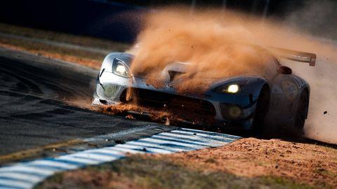 Automotive design, Automotive exterior, Hood, Bumper, Auto part, Motorsport, Dust, Synthetic rubber, Kit car, Smoke,