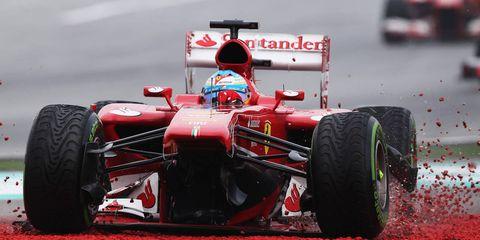 Tire, Wheel, Automotive tire, Automotive design, Open-wheel car, Automotive wheel system, Automotive exterior, Red, Formula one, Formula one tyres,