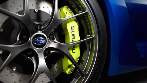 Wheel, Alloy wheel, Automotive design, Blue, Automotive wheel system, Yellow, Automotive tire, Rim, Automotive exterior, Spoke,
