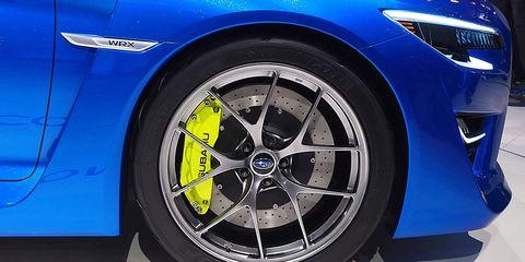 Tire, Wheel, Automotive tire, Automotive design, Alloy wheel, Blue, Automotive wheel system, Vehicle, Spoke, Rim,