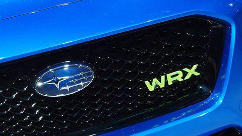 Motor vehicle, Blue, Automotive design, Automotive lighting, Automotive exterior, Electric blue, Logo, Symbol, Light, Azure,