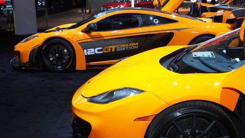 Tire, Wheel, Automotive design, Vehicle, Yellow, Land vehicle, Performance car, Car, Rim, Automotive tire,