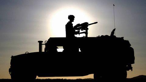 Soldier, Military person, Army, Machine gun, Combat vehicle, Military, Military vehicle, Military organization, Marines, Helmet,