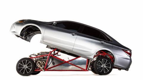 Automotive design, Product, Automotive exterior, Toy, Red, Automotive tail & brake light, Fender, Rim, Vehicle door, Automotive lighting,