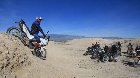 Wheel, Tire, Automotive tire, Land vehicle, Motorcycle, Vehicle, Sand, Landscape, Fender, Adventure,