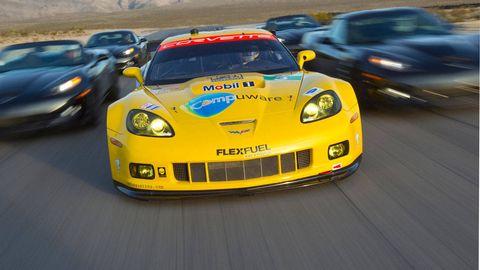 Automotive design, Vehicle, Yellow, Land vehicle, Car, Automotive parking light, Performance car, Hood, Sports car racing, Automotive lighting,
