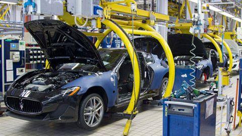 Motor vehicle, Automotive design, Rim, Automotive wheel system, Automotive tire, Performance car, Alloy wheel, Fender, Workshop, Machine,