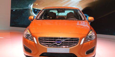 Motor vehicle, Automotive design, Daytime, Vehicle, Grille, Automotive lighting, Automotive mirror, Hood, Car, Orange,