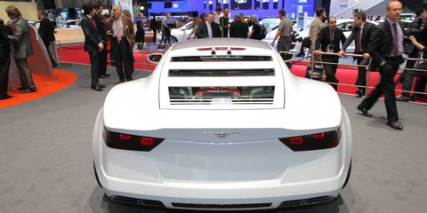 Automotive design, Event, Vehicle, Car, Personal luxury car, Auto show, Exhibition, Concept car, Luxury vehicle, Vehicle registration plate,